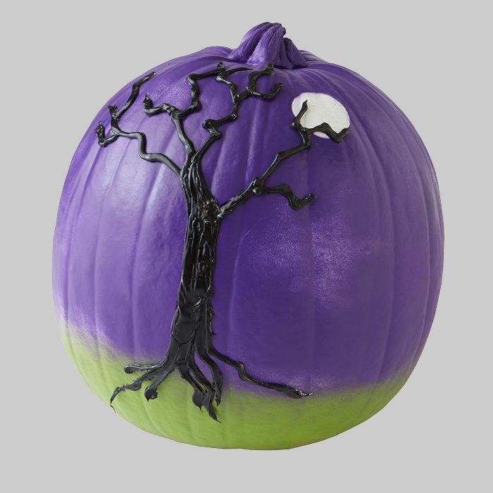 Purple and green pumpkin with a black tree on the side.