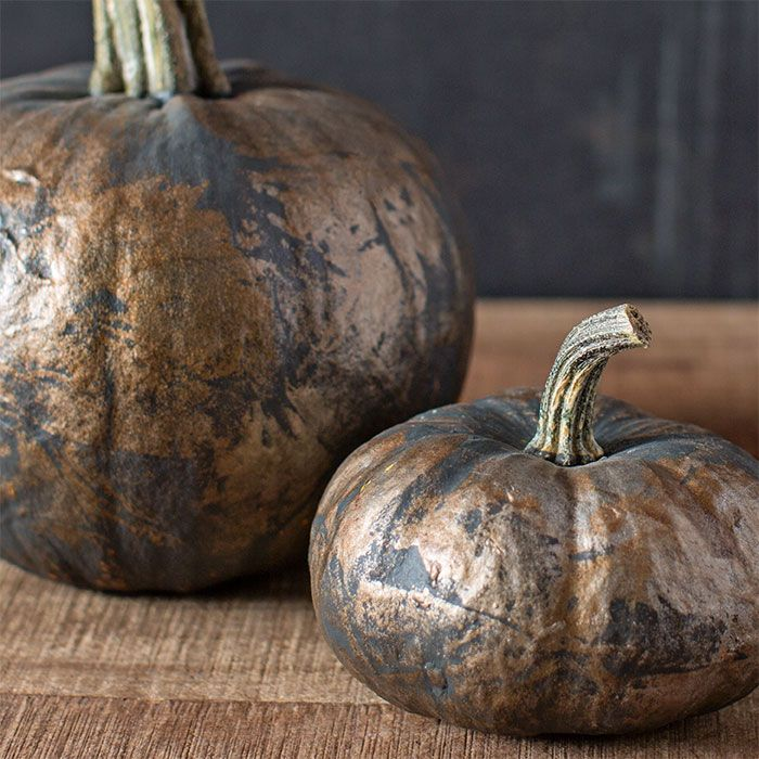 Pumpkins painted charcoal and dabbed with gold and copper paint.