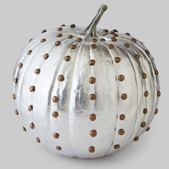 Silver painted pumpkin with tacks.